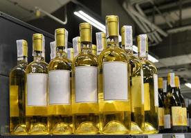 Red and white wine in bottles photo