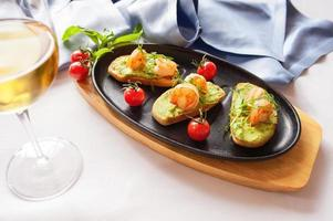 "Bruschetta with stewed salmon, cucumber and sauce ""Wasabi"""