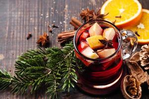 Hot wine with fresh fruit and spices