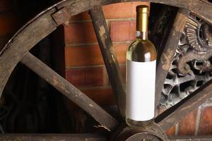 White wine on wooden wheel photo