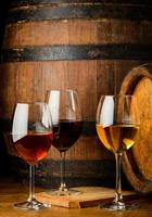 Wine galsses on barrel background