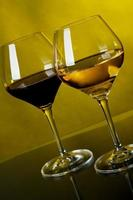 Two glasses of wine on a yellow background