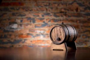 Old wooden barrel on a wood table photo