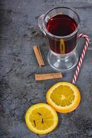 Red mulled wine, spices and candy cane