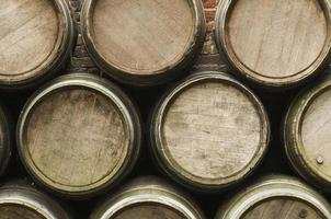 Three layers of tradition wooden barrels background photo