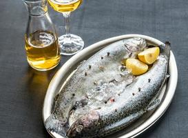 Fresh trouts in ice on the vintage metal tray photo