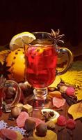 Cup of mulled wine with lemon slice and anise