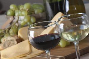Wine, grapes and cheese photo