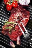 Raw beef steak and wine