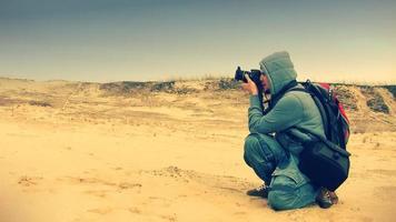 jovem fotógrafo tiroteio