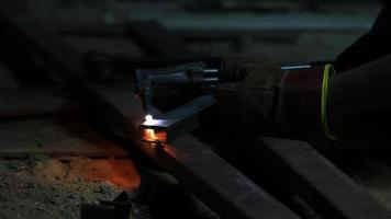 Worker cutting steel by using metal torch.