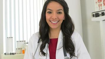 Pretty Mexican doctor sitting at desk
