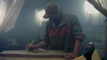 Man pushing the wood in to the machine video