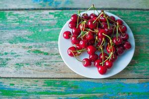 cherry on a plate on table photo