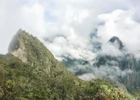 Huayna Pichu Mountain Cover by Clouds photo