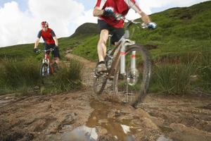 Cyclists On Countryside Track