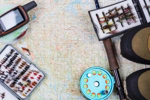 fishing tackles and shoes on paper map photo