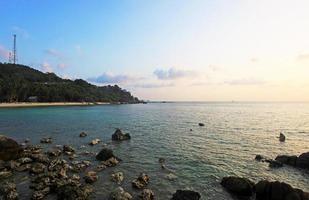 Rocks, sea, sunset on the Tropical beach in Koh Phangan photo