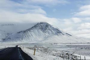 Snowy road in wintertime photo
