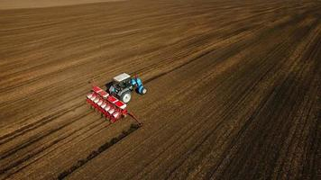 Aerial view of tractor sows sunflower