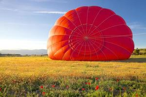 Red Hot Air Balloon Being Inflated photo