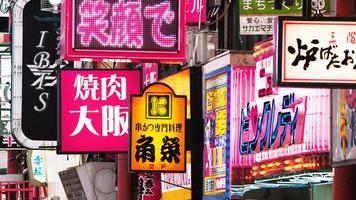 Vivid street signs in Japanese city during daytime