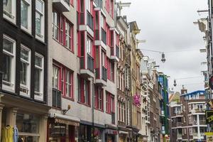 In the streets of Amsterdam center with typical houses photo