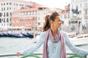 happy young woman travel by venice water bus