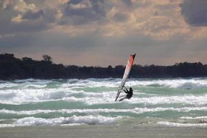 Windsurfer in Waves Before Storm photo