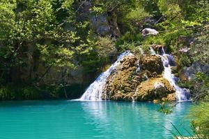 Natural waterfall and lake in Polilimnio area. Greece