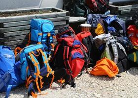 bunch of backpack before departure in the high mountains