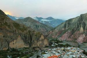 View of Iruya village and multicolored mountains photo