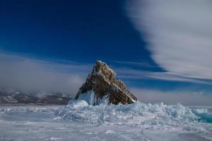 The rocky island in the ice photo