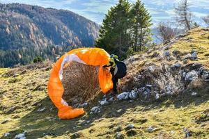 Paraglider accident. Parachute failed to start and got stuck in photo