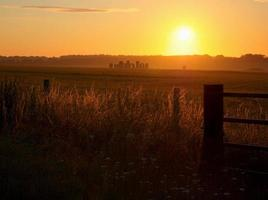 View of Stonehenge Prehistoric Monument with Summer Sunrise