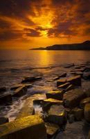Deep golden glow on a Dorset shoreline photo