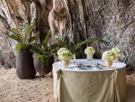 Floral arrangement at a wedding ceremony on the beach.