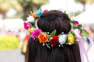 Girl with colorful flower wreath photo