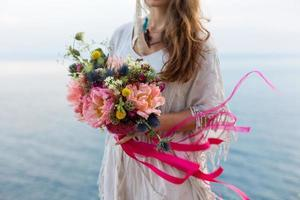 girl with a wedding bouquet boho style