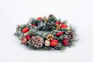 Traditional christmas wreath on white background photo