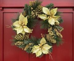 Christmas wreath on red painted door photo