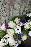detail of a Sympathy wreath in white and purple