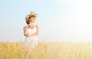 Woman on wheat field photo