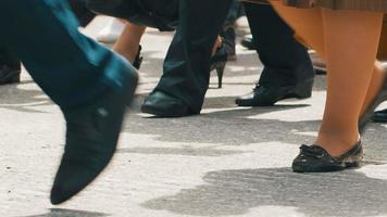 Feet of walking people at city
