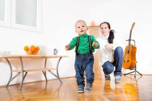 Baby boy learn to walk photo