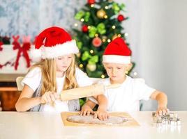 children preparing christmas cookies photo