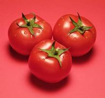 Three Tomatoes on Red