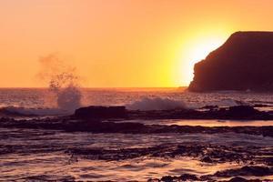 Golden sunset at Curio Bay photo