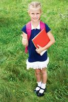 The girl has a schoolbag and books. photo