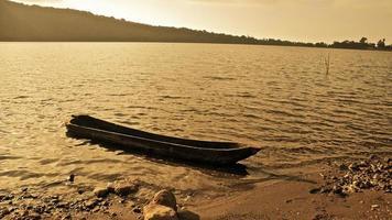 Fishing Boat Bali Indonesia Asia Bratan Wooden Boat on Water photo